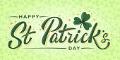 Happy St. Patrick Day lettering poster with green shamrock and orange stars. Irish traditional holiday. For greeting cart, poster, banner, flyer, web pages, social media. Isolated vector illustration