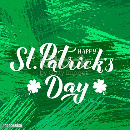 Happy St. Patrick's day calligraphy hand lettering with leaf of clover on green textured brush stroke background. Saint Patricks day greeting card. Vector template for banner, poster, flyer, postcard.