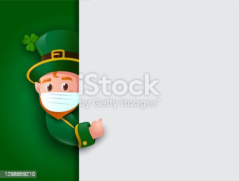 istock Happy St. Patrick's Day. Leprechaun wearing face mask with big signboard. 1298859210
