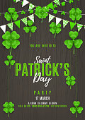 Happy St. Patrick's Day Party Flyer. Festive Decoration with Color Garlands and Clover Leaves. Vector Illustration. Invitation to nightclub.
