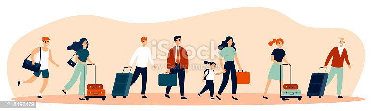 istock Happy tourists with suitcases walking together 1218493479