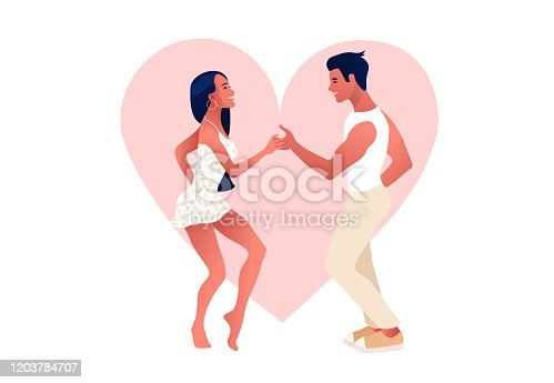 istock Happy Valentine's Day. Salsa in the city. Street dancing. Beautiful couple dancing. People in love. 1203784707