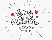 Be my Valentine handwritten decorative text with sunburst and hearts. Hand crafted design in hister style on grunge textured background. Design element for greeting card and poster