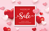 Valentines day sale poster with red and pink hearts