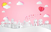 Happy valentine's day, Wedding and paper art concept,the hot air heart balloon, sun and countryside on pink sky as love