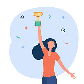 istock Happy woman holding golden cup 1288853326