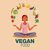 Happy woman in the lotus position with fruits and vegetables