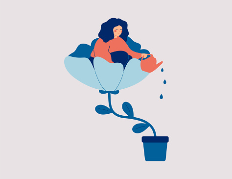 A happy woman sits in the flower and waters it. Smiling girl cares about herself and her future. Concept of love yourself and a healthy lifestyle.