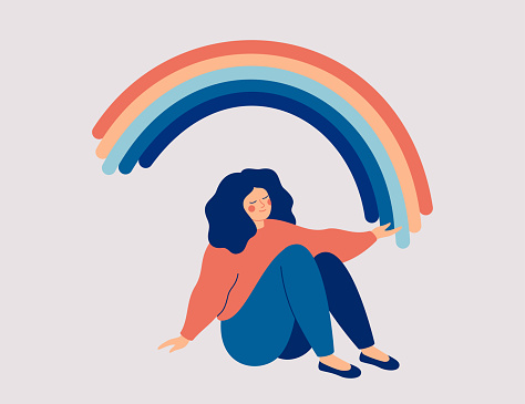 Happy woman sits on the floor and draws her arms to the rainbow. Smiled girl creates good vibe around her.