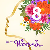 Gold colored ribbon forming a woman's head to celebrate the International Women's Day on 8th March with colorful flowers