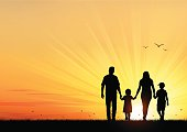 istock Happy Young Family walking at sunset 474902432