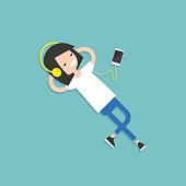 Happy young girl with headphones listening to music on a floor. Top view / flat editable vector illustration