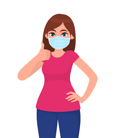 Happy young woman wearing medical face mask and showing thumbs up sign. Trendy girl covering protective surgical mask and gesturing good, success symbol. Cartoon illustration design in vector style.