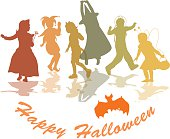 A vector silhouette illustration of Halloween themes including children dressed in costumes dancing and having fun, an orange bat, and a text box reading Happy Halloween.