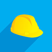 Vector illustration of a yellow hard hat against a blue background in flat style.