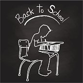 Back to school chalkboard illustration of an elementary school student at their desk and hard at work on their writing skills