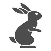 Hare solid icon, wild animal concept, rabbit on back paws sign on white background, cute bunny from forest icon in glyph style for web design. Vector graphics