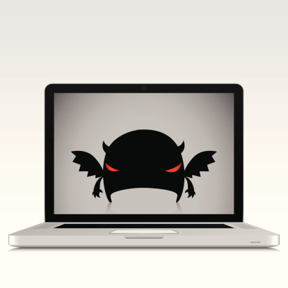 Harmful Software Character On Laptop Screen