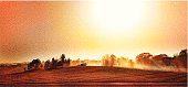 Stipple illustration of a combine harvesting crops. The dust from many combines working in the area creates a hazy sky.