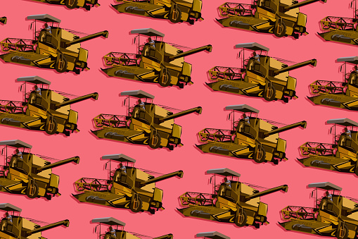Pattern of farmer driving a combine harvester during high season