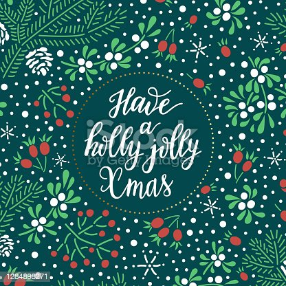 istock Have a holly jolly Xmas hand drawn lettering phrase on the Christmas colored background with spruce twigs, snowflakes, white mistletoe and red rowan berries. 1284898271