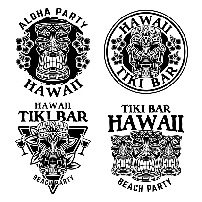 Hawaiian tiki wooden head set of four vector monochrome emblems, badges, labels, stickers or symbols in vintage style isolated on white background