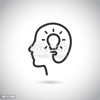 istock Head with bulb icon on gray background. 961472666