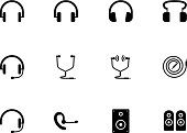 Headphones and speakers icons on white background.