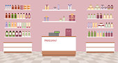 Health and beauty store with colorful cosmetic products in plastic bottles in shelves.
