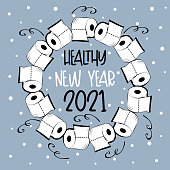 Healthy New Year 2021 - Toilet paper wreath and snowy background. Funny greeting card for New Year in covid-19 pandemic self isolated period.