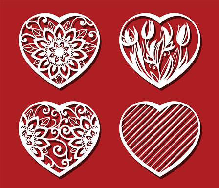 Heart cut on red background for laser cutting. Set of white ornamental hearts. Tulips, sunflower in heart shape. Vector illustration.