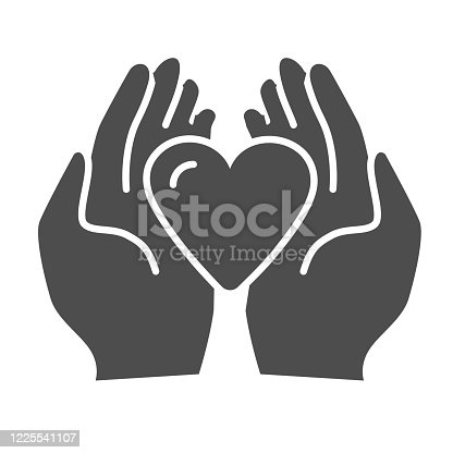 istock Heart in palms solid icon, love or health care concept, Human hands holding heart vector sign on white background, giving heart symbol in glyph style mobile and web design. Vector graphics. 1225541107