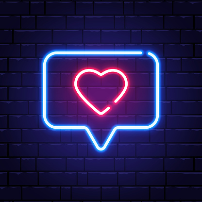 Heart neon sign. Neon like in speech bubble on brick wall. Romantic light banner. Bright night neon signboard. Romantic design for Valentines Day. Vector illustration
