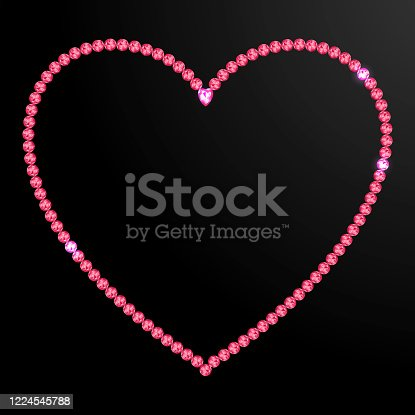 Heart of red, purple gemstones on a black background. Heart shaped outline of rubies on a black background. Unique heart made of jewelry.