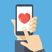 Heart on smartphone screen. Hand holds smartphone, finger touches heart button. Modern concept for web banners, web sites, infographics. Creative flat design vector illustration