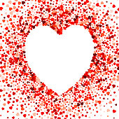 Heart shape empty space on red heart shape confetti on white background. Ideal for valentine card.