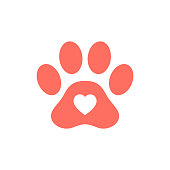 Heart shape icon in red pink colored animal paw print.