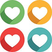 Heart shape  icons vector illustration. The Icons are white on top of four different colors, red, green, blue and orange/yellow. The icons have a shadow effect to their left side.
