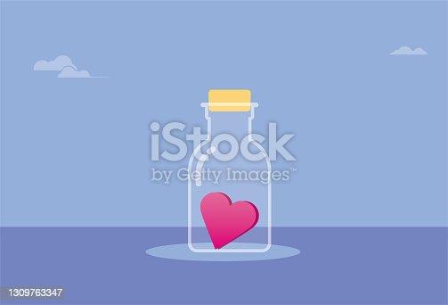 istock Heart shape inside the bottle 1309763347