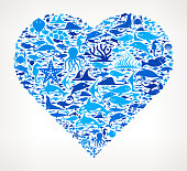 Heart shape Ocean and Marine Life Blue Icon Pattern  These blue and aqua flat icons feature such marine life icons as a sea shell, dolphin, whale, shark, reef, water, an octopus, waves and various specious of fish. The seamless pattern is flat and the icons vary in size and shades of color. Download includes vector graphic and jpg file.