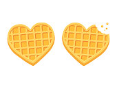 Two heart shaped waffles, with bite and crumbs. Cute cartoon style vector illustration.