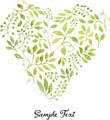 Heart-shaped floral tag with green leaves and branches