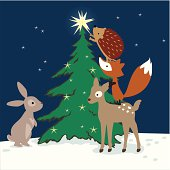 Vector illustration of forest animals decorating a Christmas tree on a winter night.