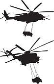 Vector silhouette of a two helicopters carrying humvees.
