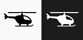 Helicopter Icon on Black and White Vector Backgrounds. This vector illustration includes two variations of the icon one in black on a light background on the left and another version in white on a dark background positioned on the right. The vector icon is simple yet elegant and can be used in a variety of ways including website or mobile application icon. This royalty free image is 100% vector based and all design elements can be scaled to any size.