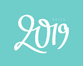 Hello 2019. Vector illustration on a blue background. Happy New Year Concept. Lettering and calligraphy.