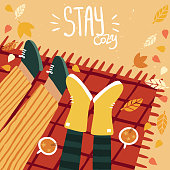 Woman and man on a picnic in fall and lettering stay cozy. Happy cute couple on autumn background with leaves and trees. Illustration is for your card, poster, flyer.