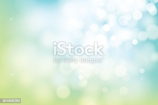 istock hello spring green bokeh blur abstract background. 924505250