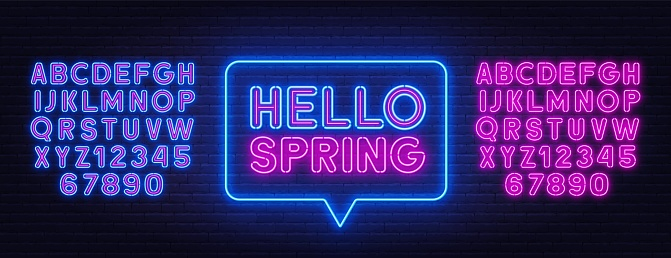 Hello Spring neon sign on brick wall background.