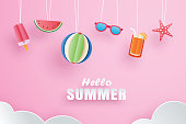 Hello summer with decoration origami hanging on pink background. Paper art and craft style.